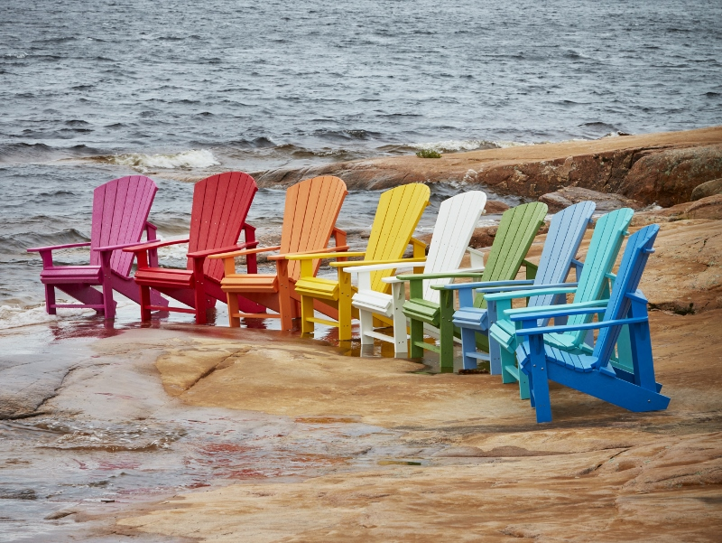 Recycled Plastic Adirondack Chairs On Rock
